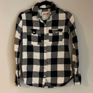 Two long sleeved black/white checked flannels, xs